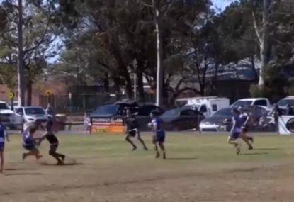 Scrambling halfback gets nailed by big hit!