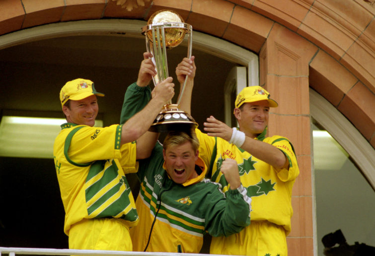 Shane Warne celebrates with Steve and Mark Waugh