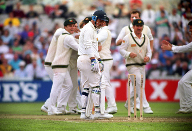 England's Mike Gatting (centre) is bowled out by Shane Warne