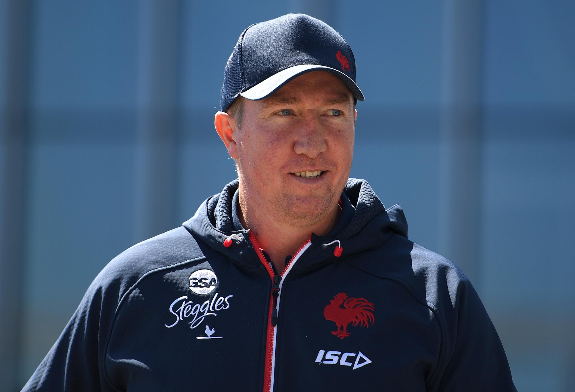 Sydney Roosters coach Trent Robinson arrives to address media during a press conference in Sydney