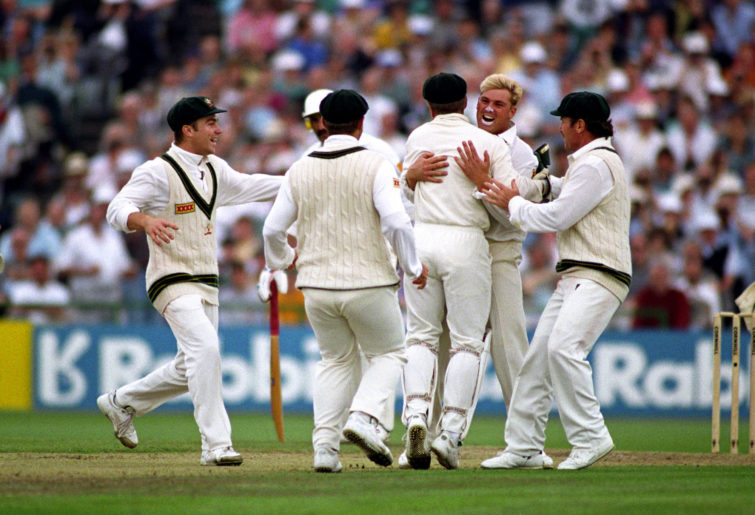 Shane Warne of Australia celebrates taking the wicket of Mike Gatting