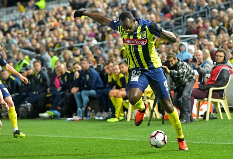 Usain Bolt controls the ball in his Central Coast Mariners debut.