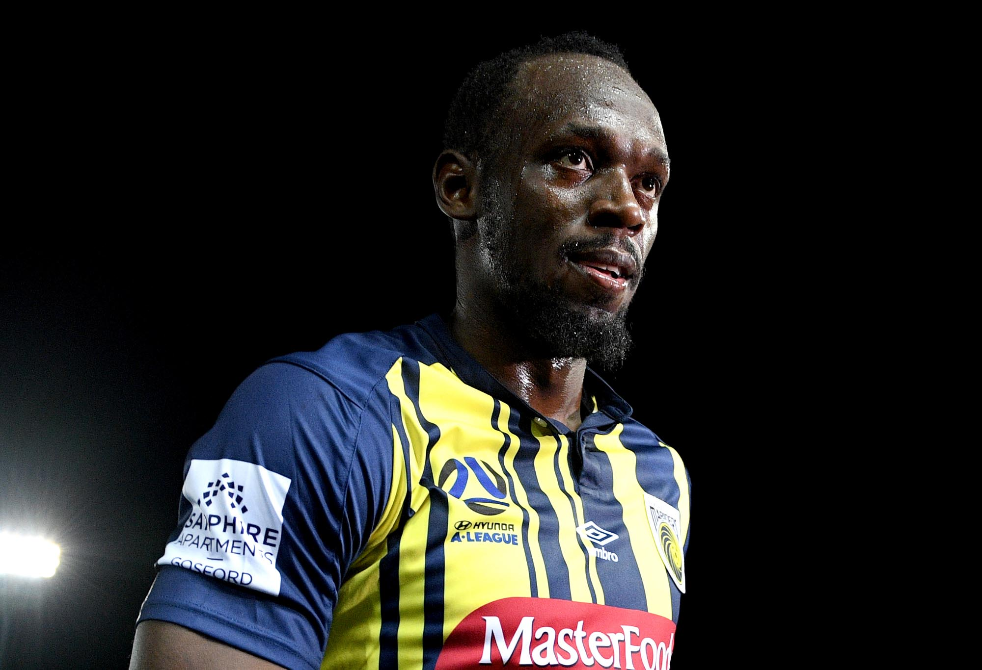 Usain Bolt of the Mariners leaves the field following his Central Coast Mariners debut.