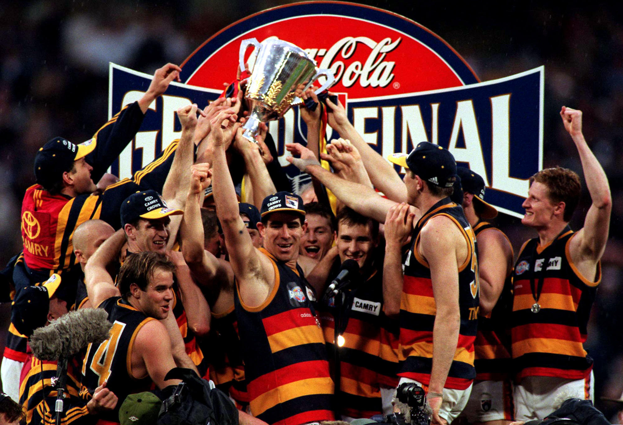 The Adelaide Crows team celebrates their victory over St Kilda in the 1997 AFL Grand Final at the MCG in Melbourne, Australia.