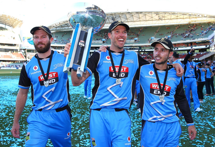 Michael Neser, Ben Laughlin and Jonathan Wells of the Strikers walk a lap of honour with the trophy after winning the Big Bash League Final match between the Adelaide Strikers and the Hobart Hurricanes at Adelaide Oval on February 4, 2018 in Adelaide, Australia.