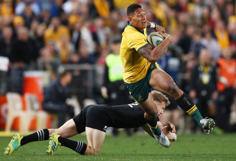 Israel Folau of the Wallabies evades a tackle