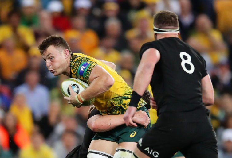 Jack Dempsey of the Wallabies is tackled during the Bledisloe Cup match between the Australian Wallabies and the New Zealand All Blacks at Suncorp Stadium on October 21, 2017 in Brisbane, Australia.
