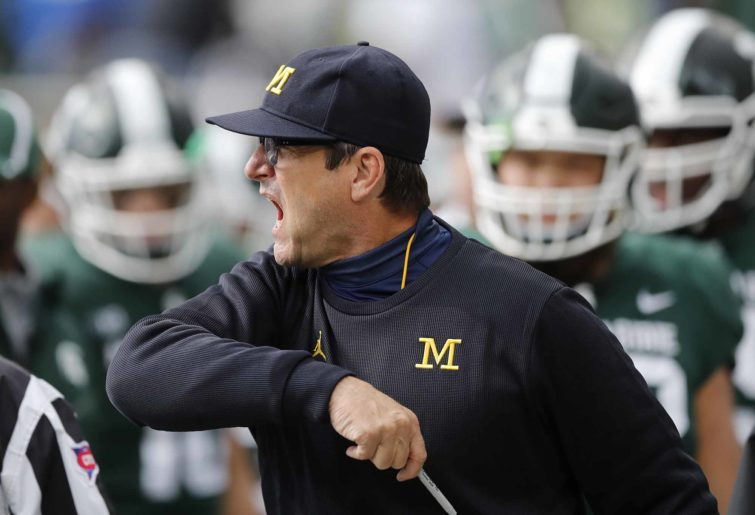 Michigan head coach Jim Harbaugh College football