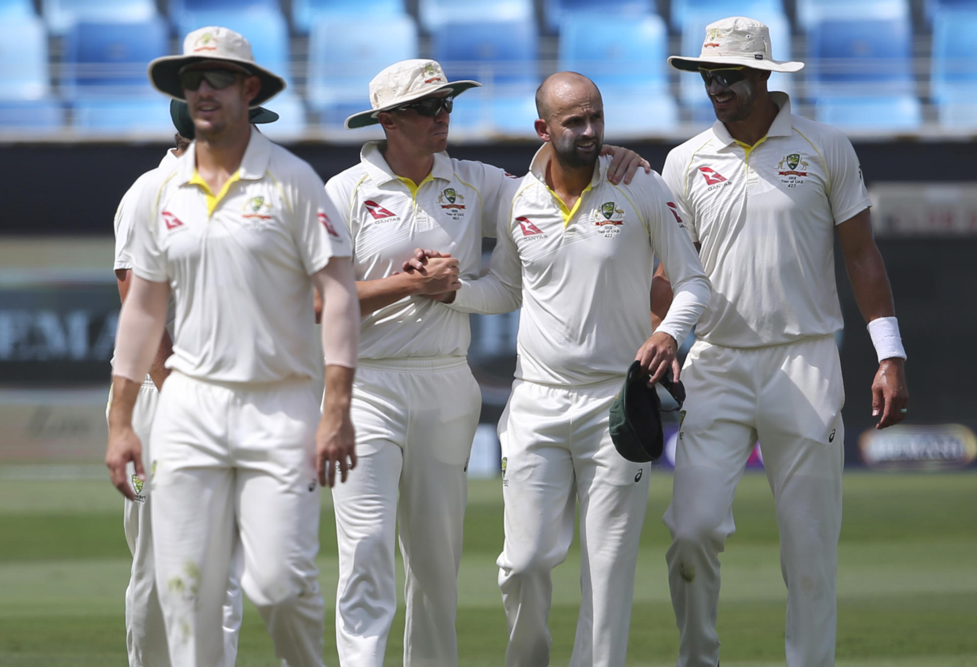 Nathan Lyon and teammates celebrate a wicket