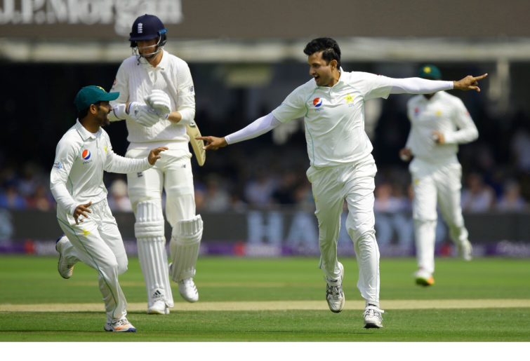 Mohammad Abbas celebrates against England.