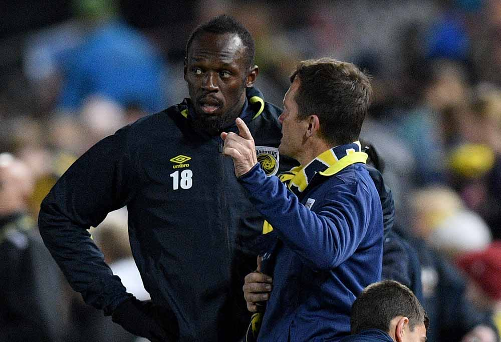 Usain Bolt speaks to Mike Mulvey