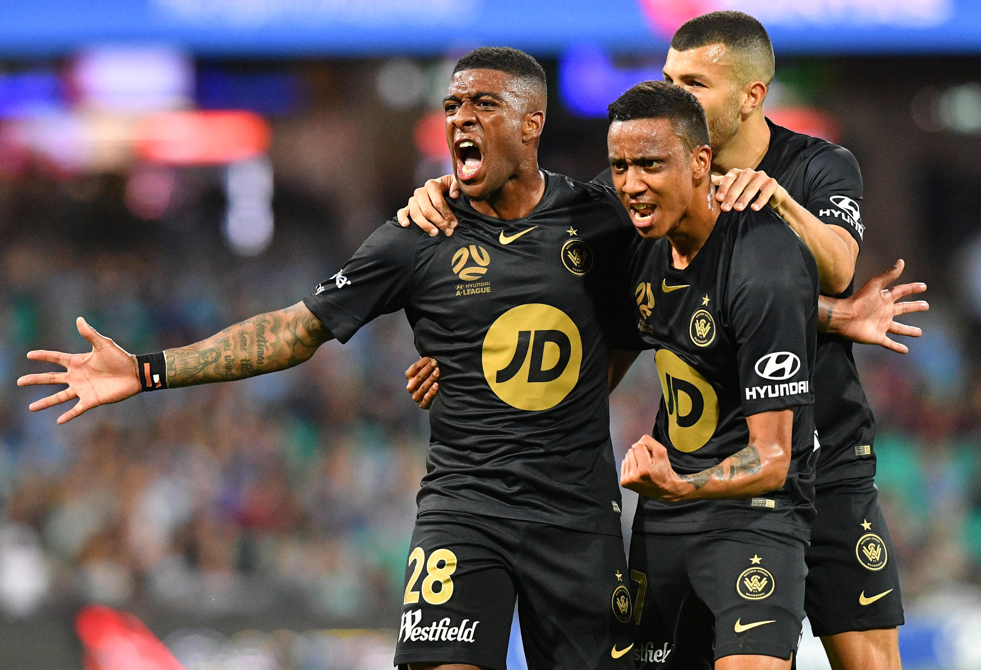Roly Bonevacia (left) of the Wanderers reacts after scoring