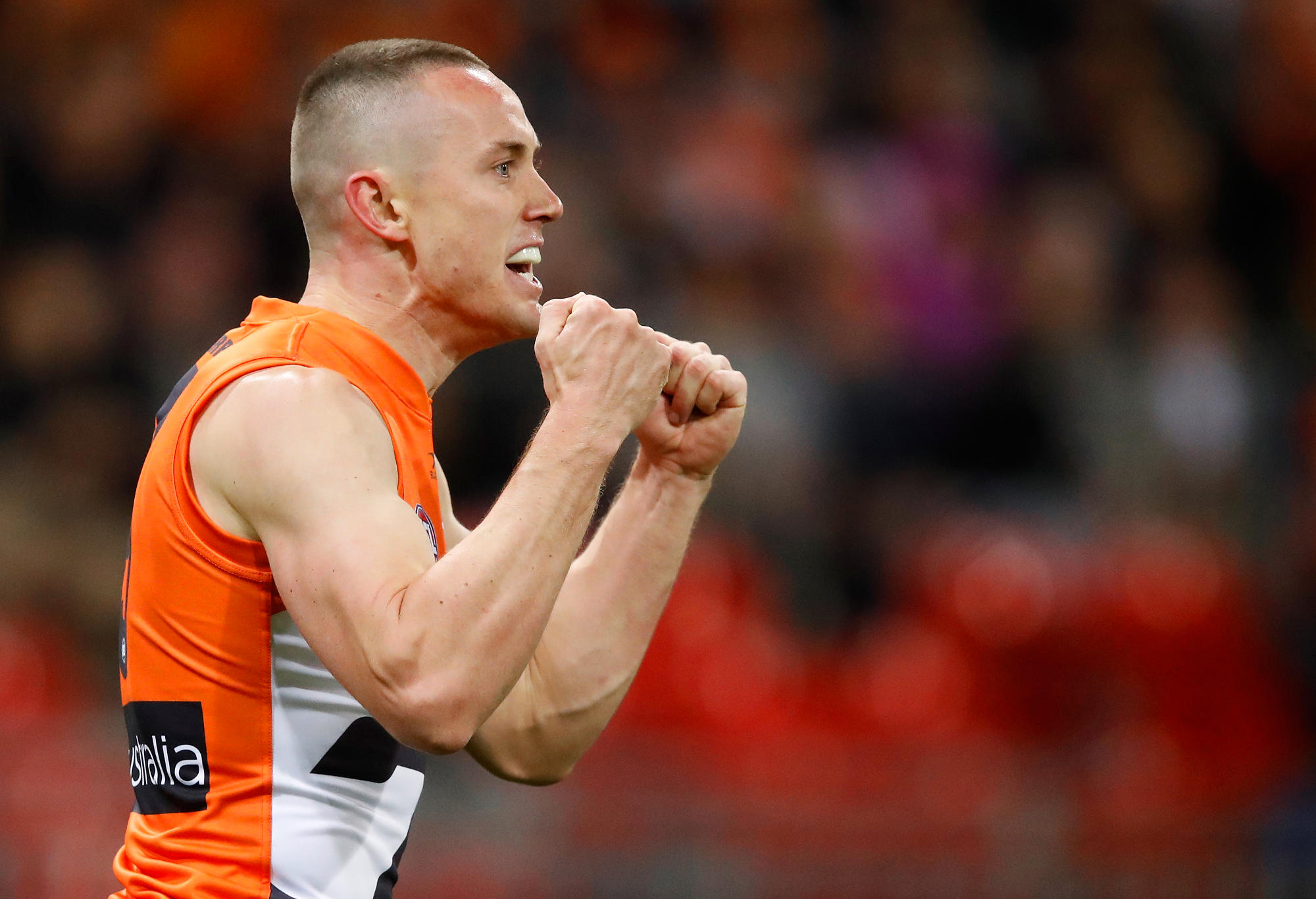 Tom Scully of the Giants celebrates a goal in his 150th game during the 2017 AFL First Semi Final match between the GWS Giants and the West Coast Eagles at Spotless Stadium on September 16, 2017 in Sydney, Australia.