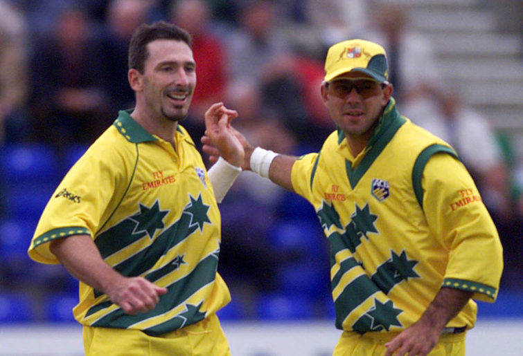 Australia's Damien Fleming, left, is congratulated by Ricky Ponting after claiming a wicket