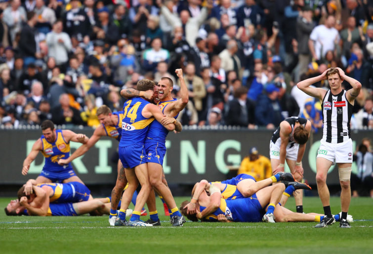 Dom Sheed and teammates celebrate winning the 2018 AFL Grand Final