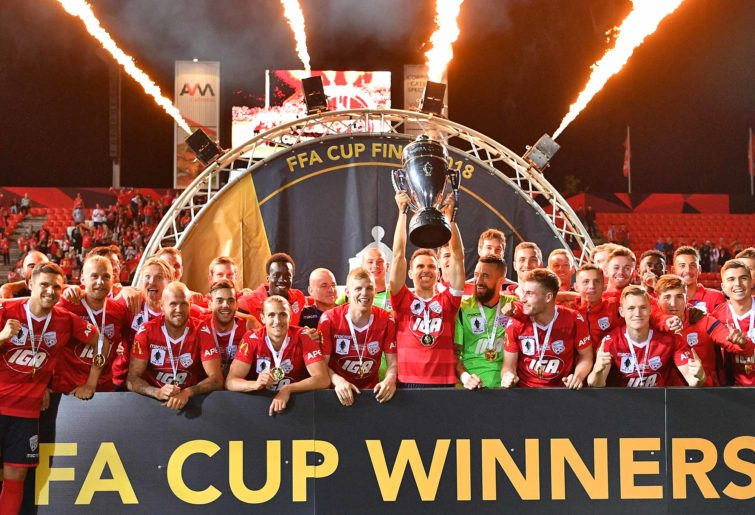 Adelaide United players celebrate after winning the FFA Cup final
