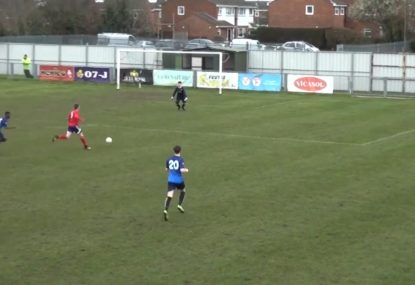Striker chips the keeper from outside the box
