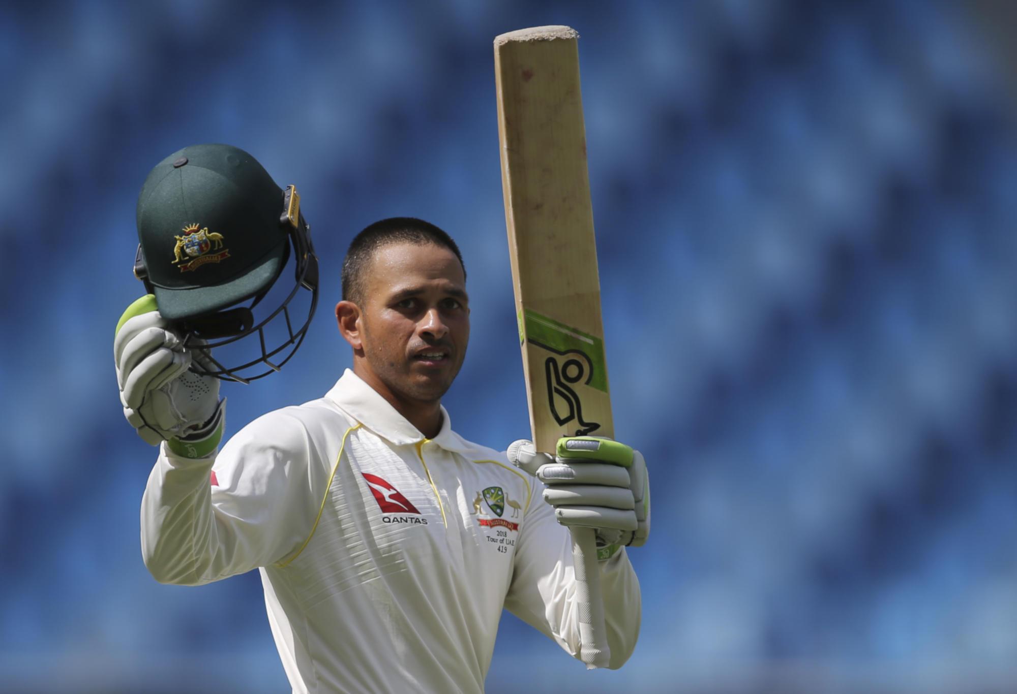 Usman Khawaja celebrates a century