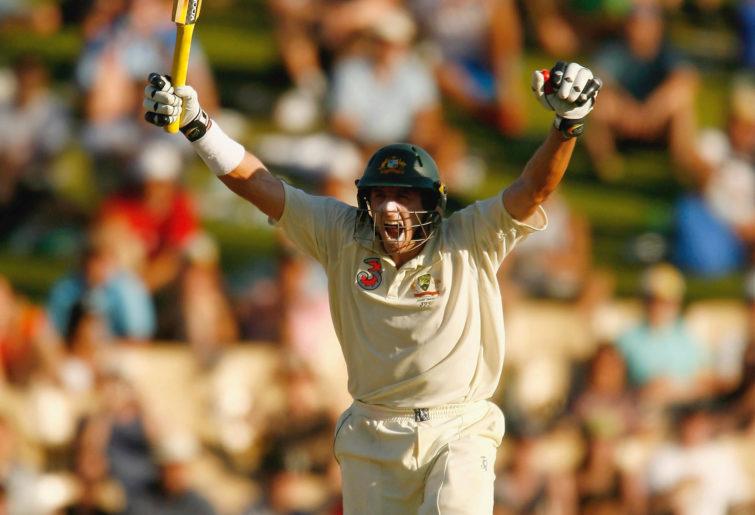 Michael Hussey of Australia celebrates scoring the winning runs