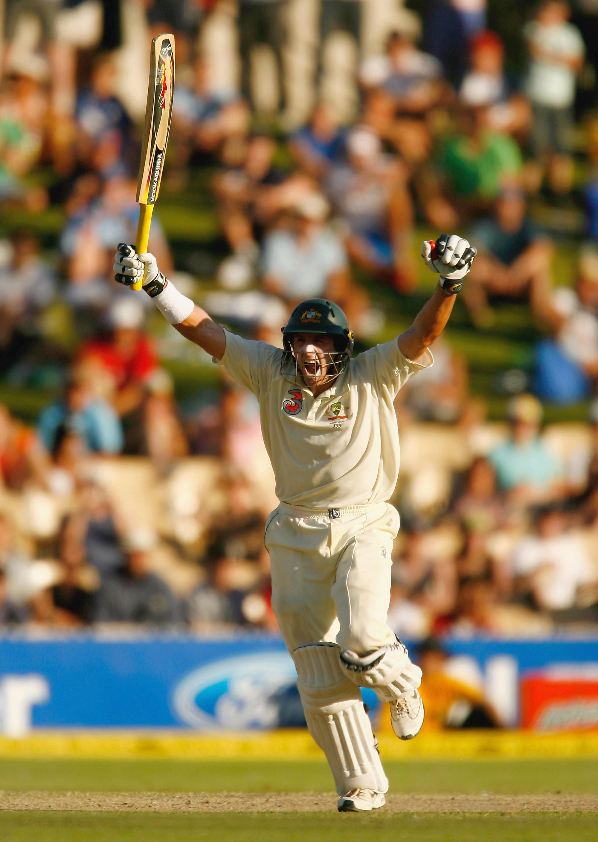 Michael Hussey of Australia celebrates scoring the winning runs