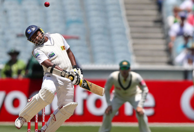Mitchell Johnson of Australia bowls a bouncer to Rangana Herath