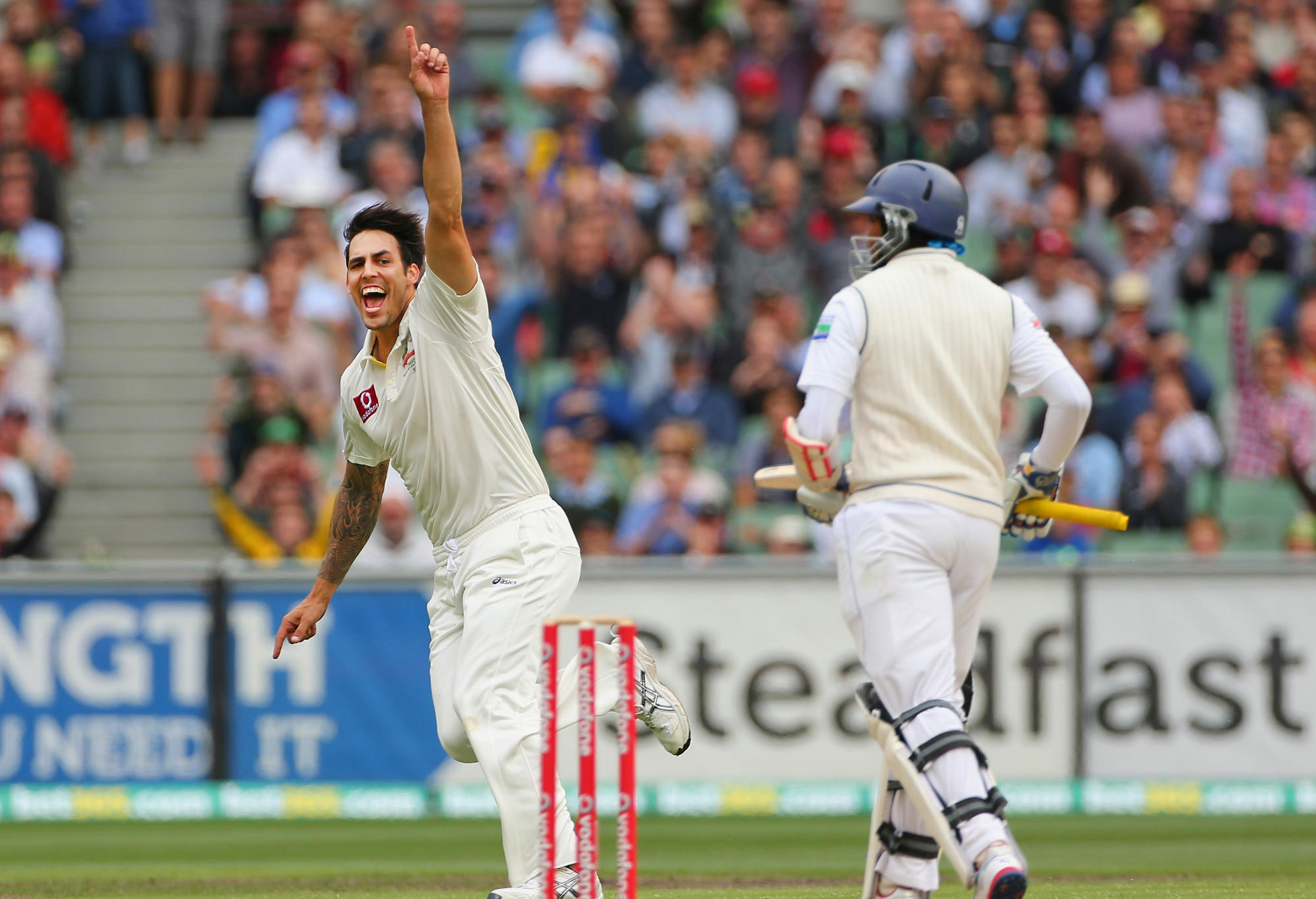 Mitchell Johnson of Australia celebrates after dismissing Tillakaratne Dilshan