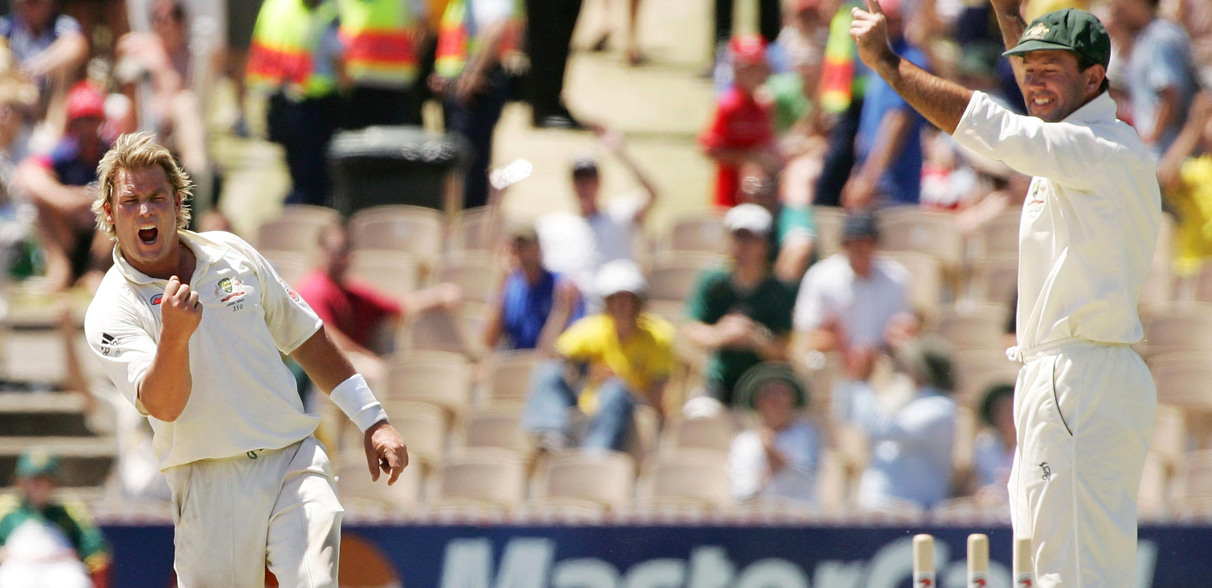 Shane Warne of Australia and team-mate Ricky Ponting celebrate