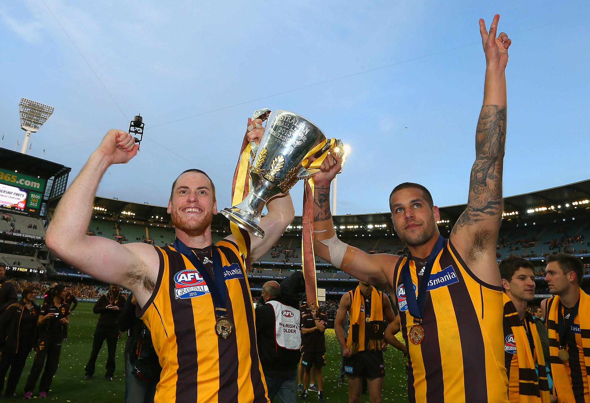 Jarryd Roughead and Lance Franklin of the Hawks celebrate with the Premiership Cup.