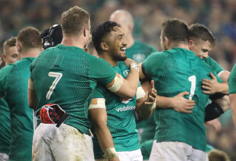 Ireland's Josh van der Flier, left, and Ireland's Bundee Aki embrace.