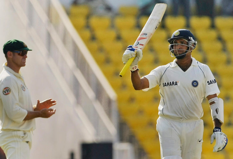 VVS Laxman raises his bat.