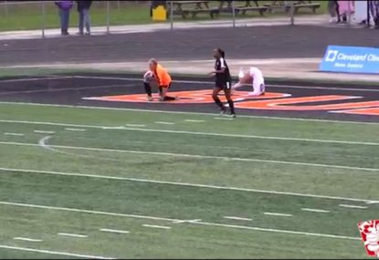 Striker gets her head stuck in the turf after collision with goalkeeper