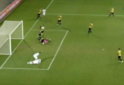 Footballer scores while tending to injured teammate