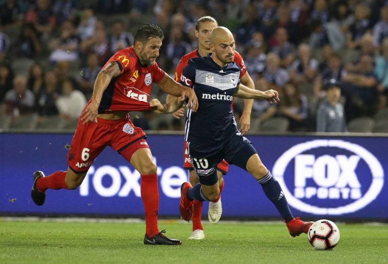Vince Lia of Adelaide United and James Troisi of the Victory