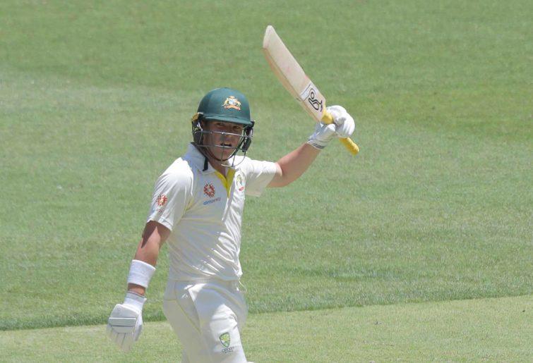 Marcus Harris of Australia raises his bat