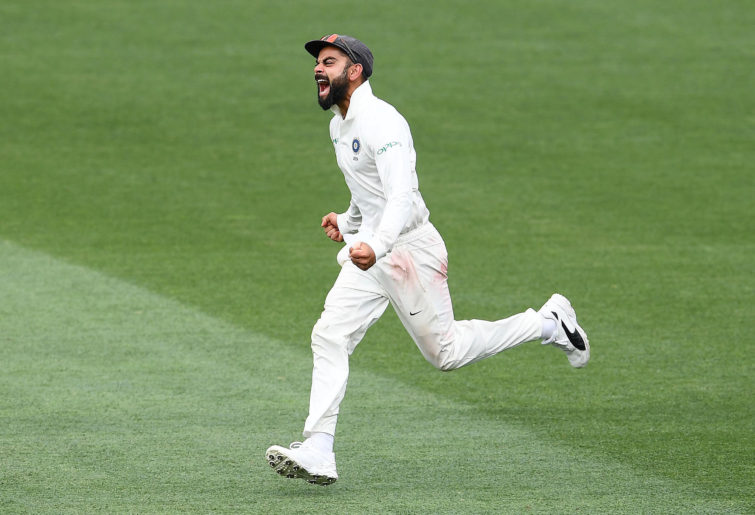 Virat Kohli celebrates taking a wicket.