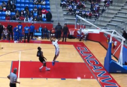 College basketballer alley-oops to himself for EPIC one-handed dunk!