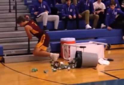 Basketballer bundles over bin and water cooler in comical intercept blooper