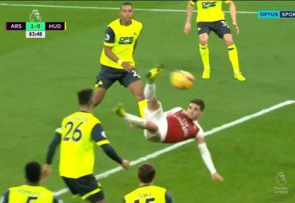 Brilliant bicycle kick sees Arsenal gun down Huddersfield