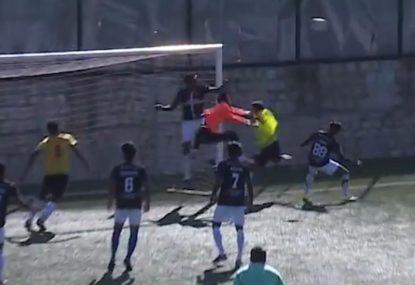 Goalie shows off an overhead smash that would impress Roger Federer