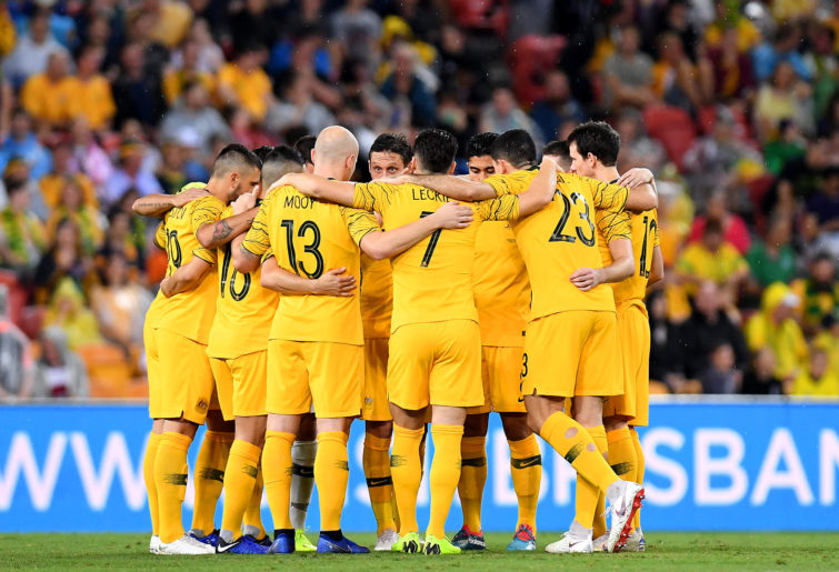 Mark Milligan talks to the Socceroos in a team huddle