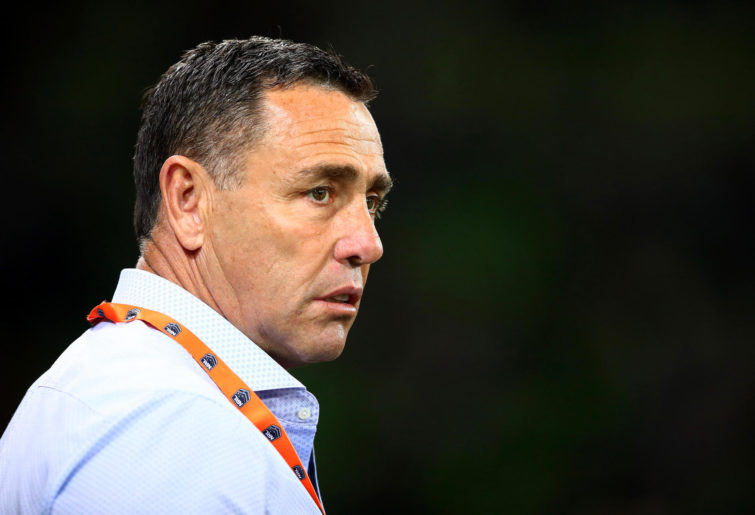 Sharks coach Shane Flanagan watches his team warm up