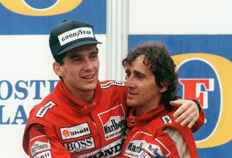 Two formula one drivers on the podium