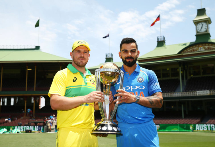 Aaron Finch and Virat Kohli pose with a trophy