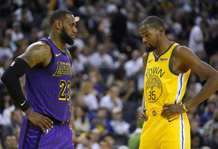 Los Angeles Lakers forward LeBron James (23) talks to Golden State Warriors forward Kevin Durant