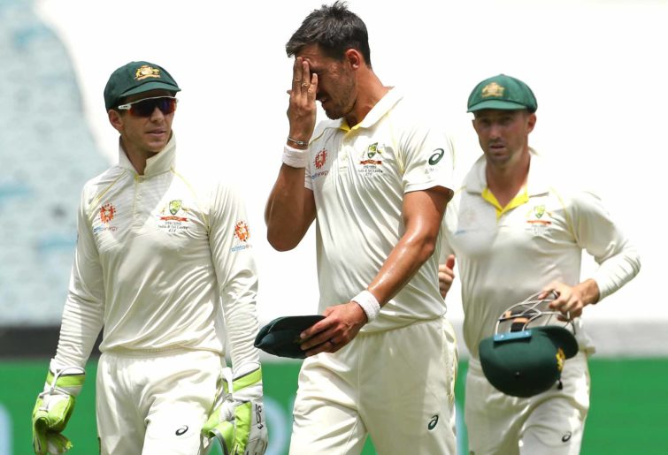 Mitchell Starc of Australia (centre) with teammates Tim Paine (left) and Shaun Marsh