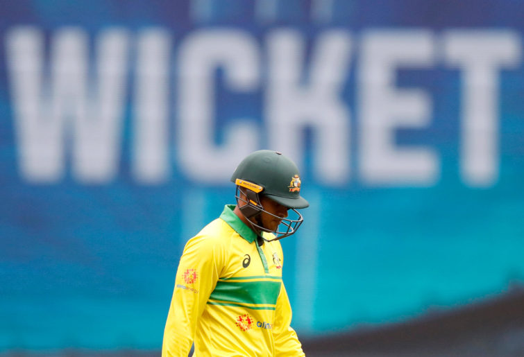 Usman Khawaja leaves the field after being dismissed