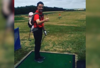 Legend dad doesn't let baby stop him from hitting the driving range