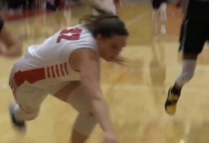 Extreme defensive effort gets physical with a somersault on the floor