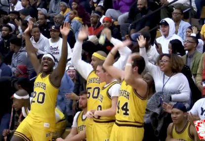 Crowd goes nuts for rim-hanging two-handed jam!
