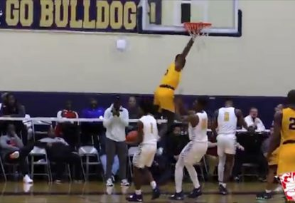 Prodigy hangs from the rim on freakish one-hand dunk